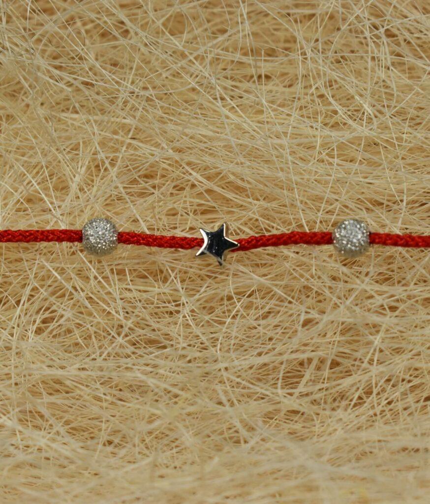 bransoletka srebro próba 925 z kulkami i gwiazdkami sznurkowa czerwona