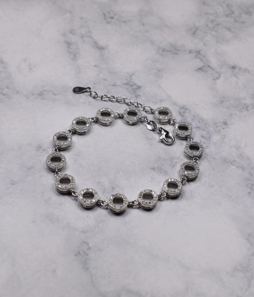 bransoletka srebrna próba 925 kółeczka z cyrkoniami wieloelementowa z przedłużką