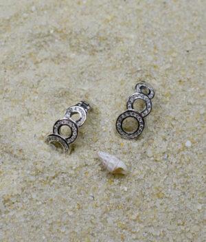 kolczyki srebrne próba 925 połączone kółeczka z cyrkoniami zapięcie angielskie
